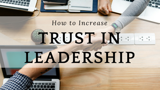"Two business people shaking hands with the phrase ""How to increase trust in leadership"" written over the image."