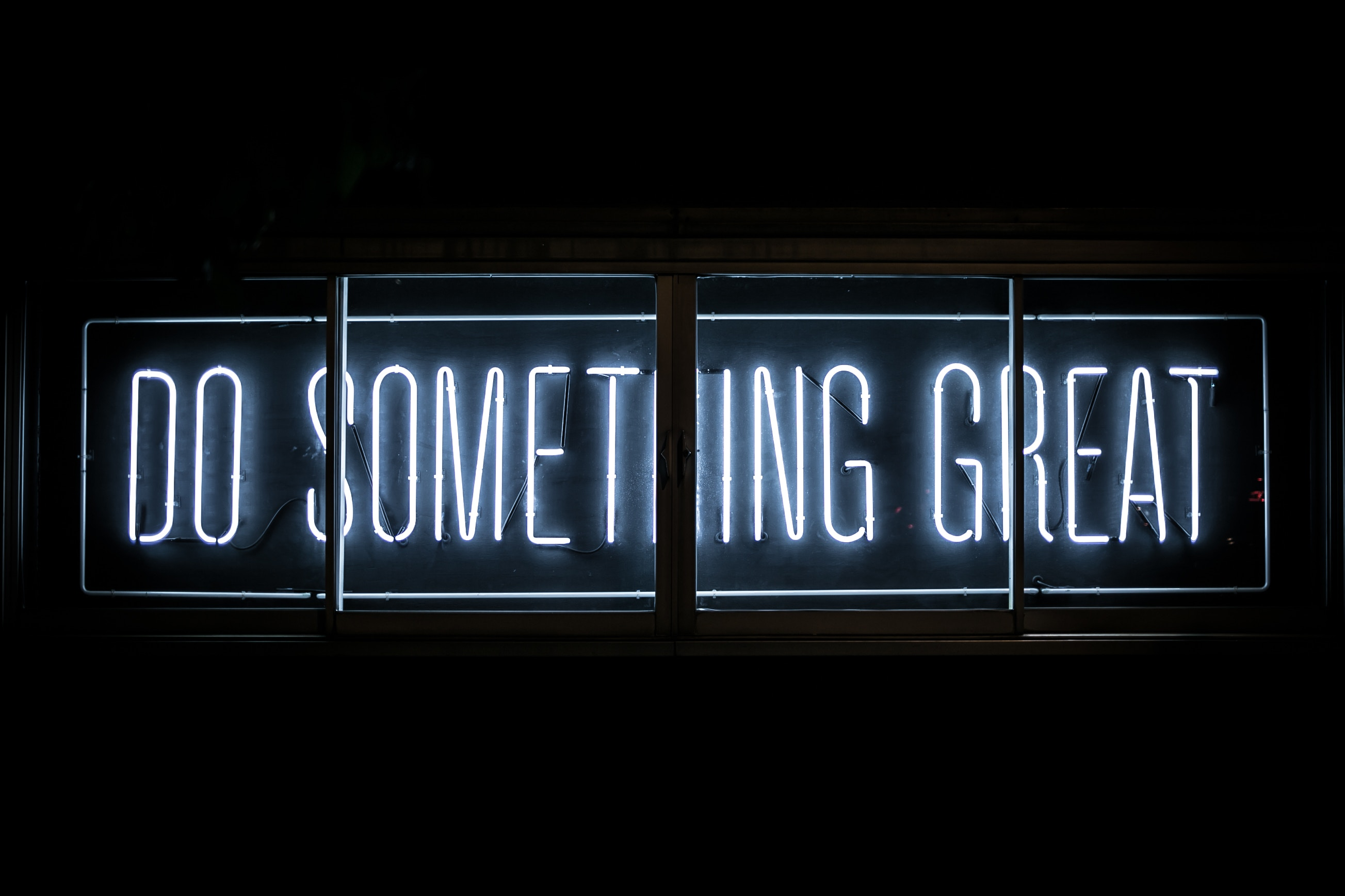 """White neon sign that says """"Do Something Great"""""""