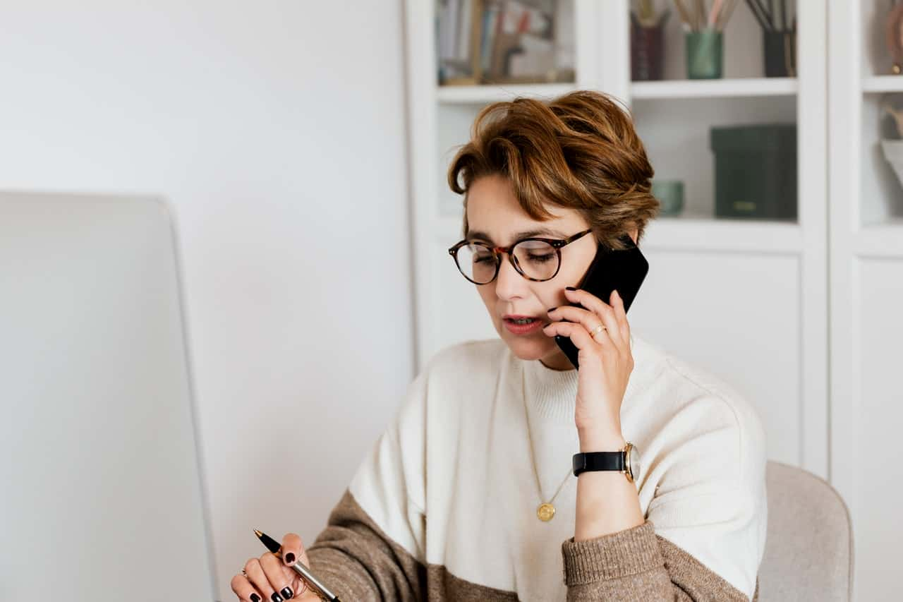 Photo of a woman using a time management system.
