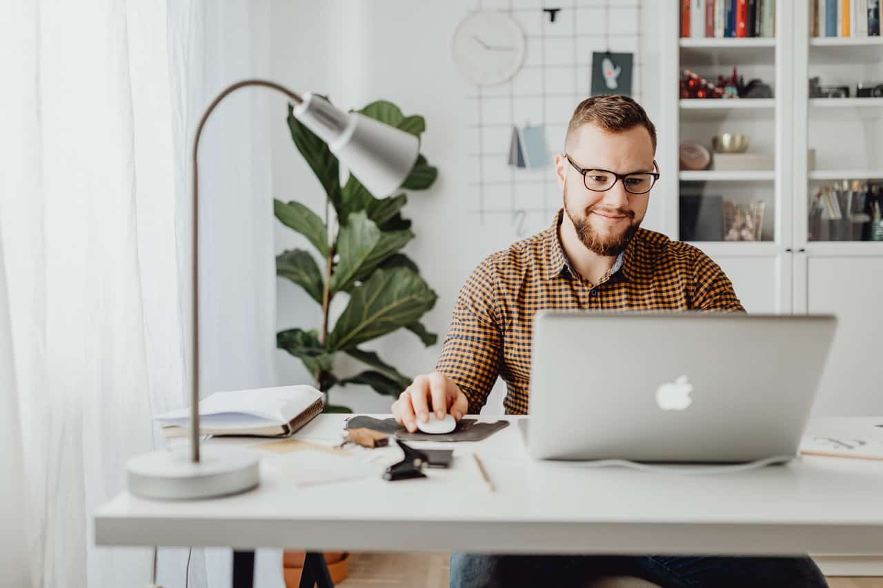 Photo of an engaged employee working in a home office.