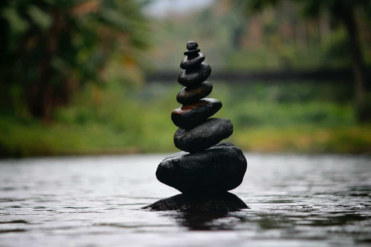 Photo of stones balancing in a forest.
