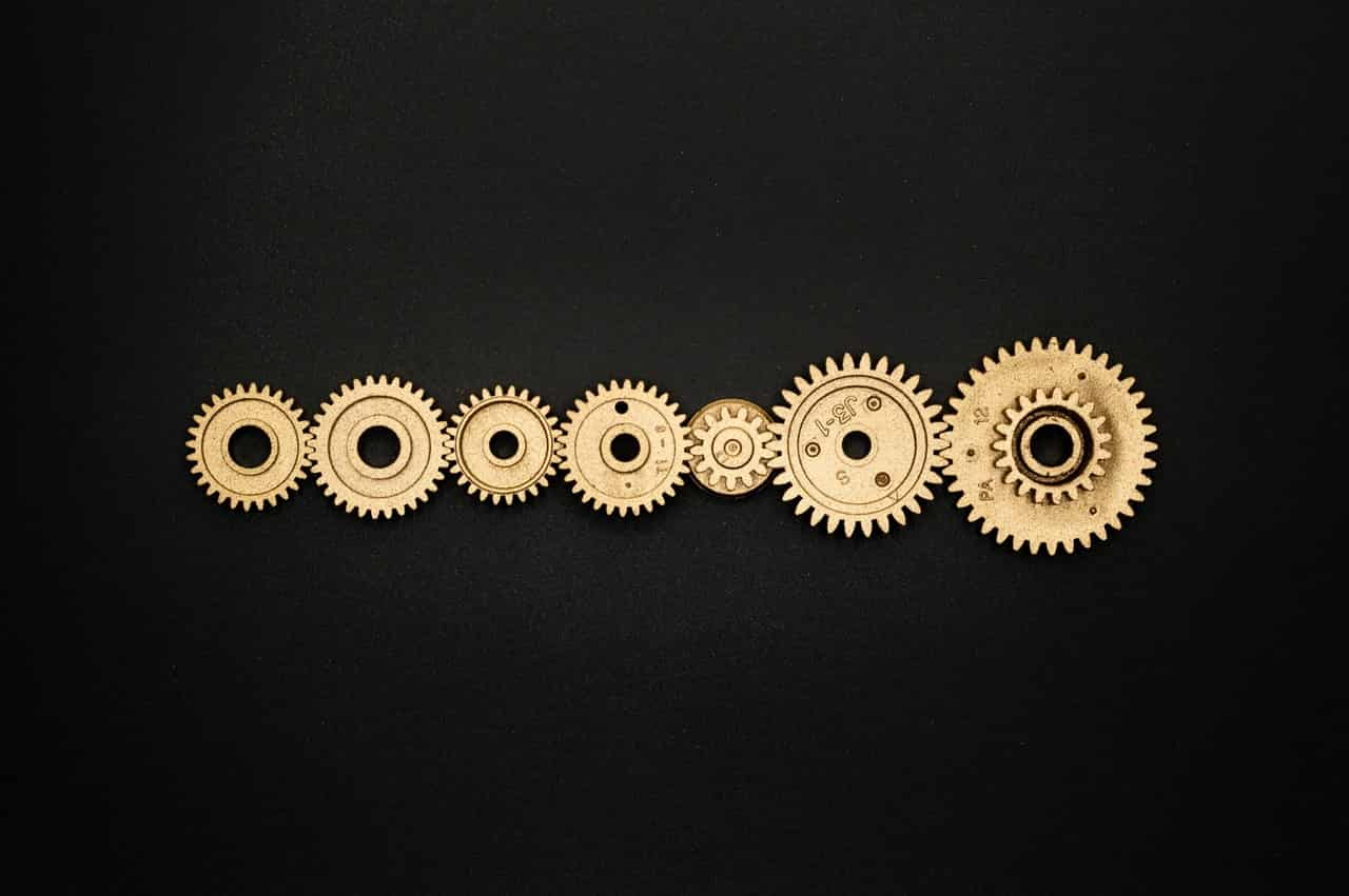photo-of-golden-cogwheel-on-black-background-3785927 (1)